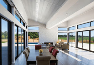 Contemporary Living room with multiple sliding patio doors for window walls