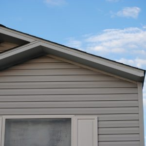 House with grey Hardie siding and window